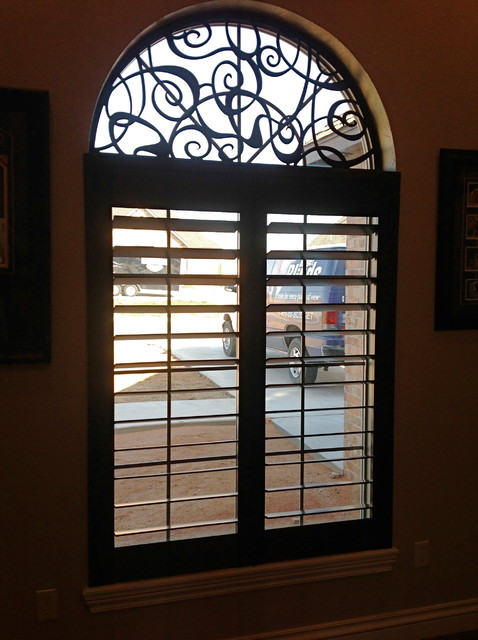 Arched Window With Wood Shutters And Tableaux Faux Iron