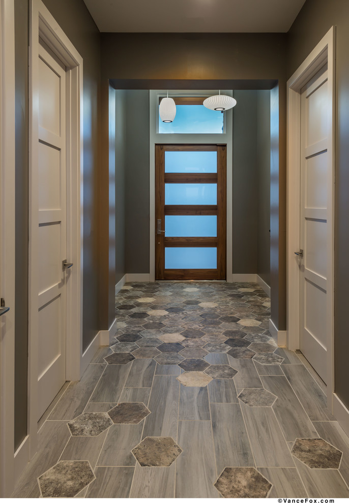 Entryway - small contemporary ceramic tile and gray floor entryway idea in Other with gray walls and a dark wood front door