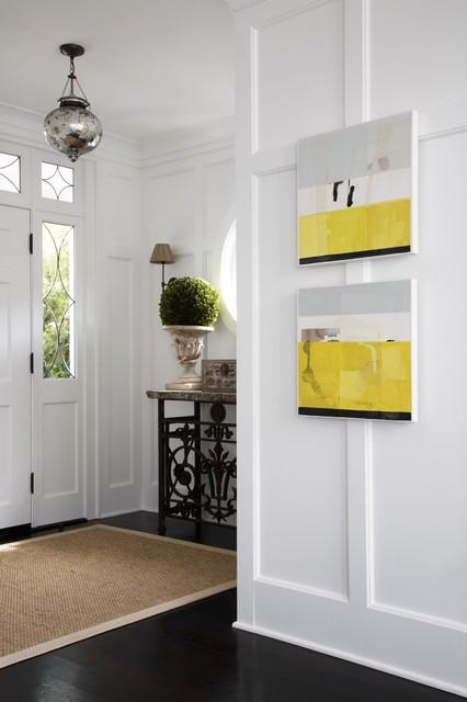 Entryway - transitional dark wood floor entryway idea in Los Angeles with white walls