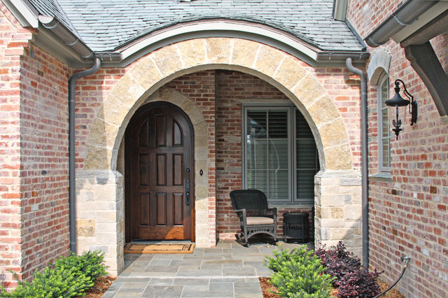Inspiration for a mid-sized timeless entryway remodel in Dallas with a dark wood front door