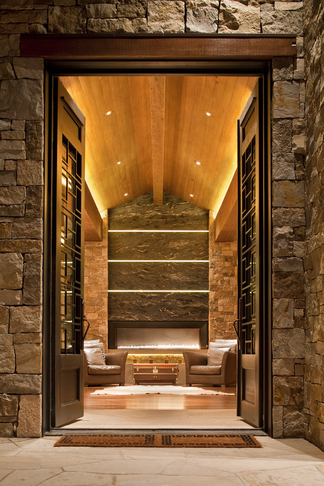 Inspiration for a contemporary double front door remodel in Denver with a dark wood front door