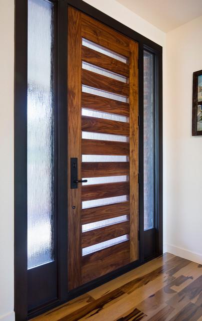 Asymmetrical interior contemporary entry austin by for Asymmetrical balance in interior design