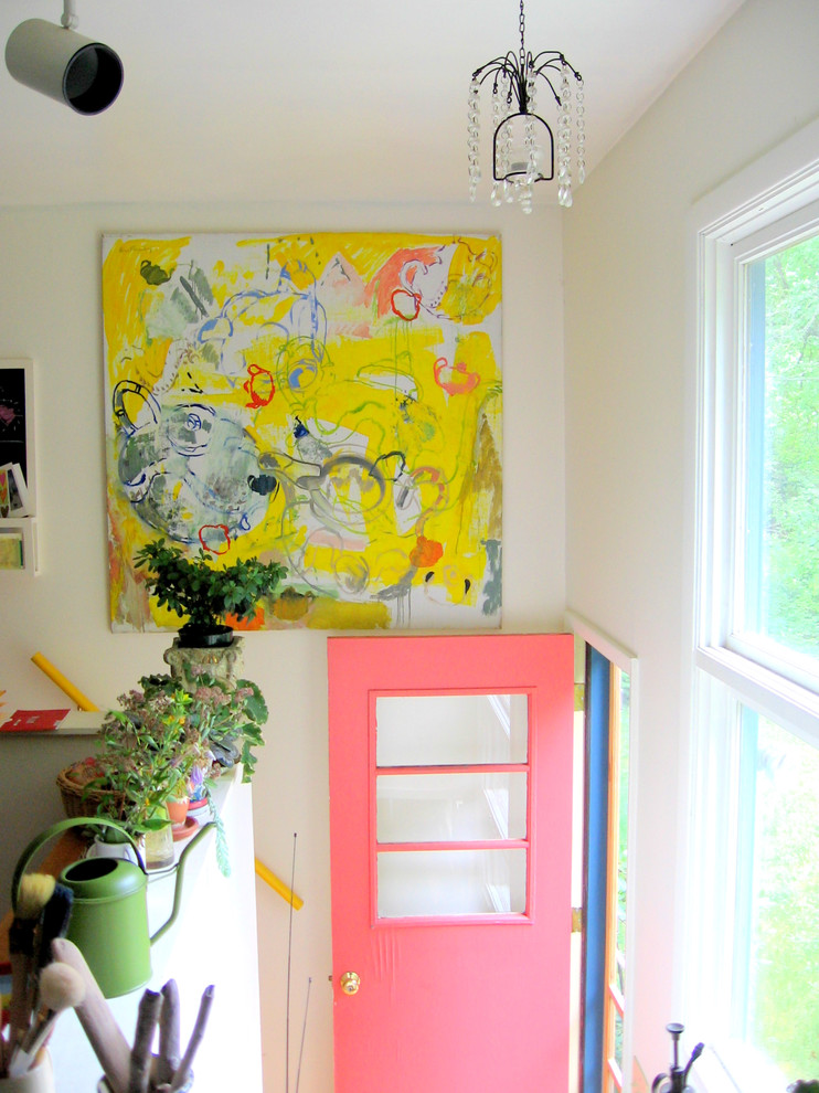Example of an eclectic entryway design in Burlington with white walls