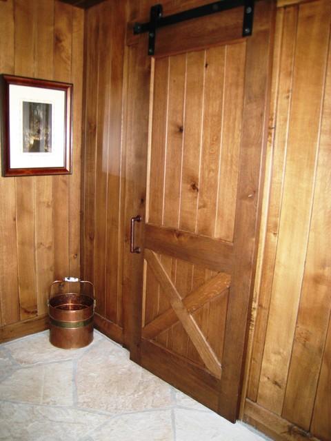 Barn door on sliding hardware farmhouse entry by for Farmhouse sliding door