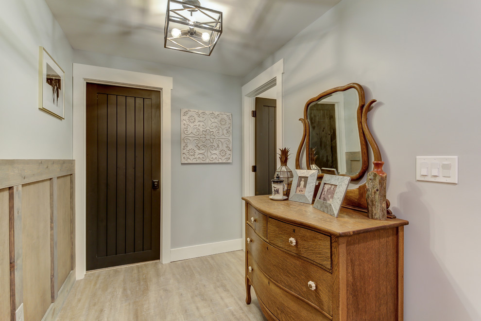 Inspiration for a mid-sized cottage vinyl floor and beige floor entryway remodel in Dallas with blue walls and a dark wood front door