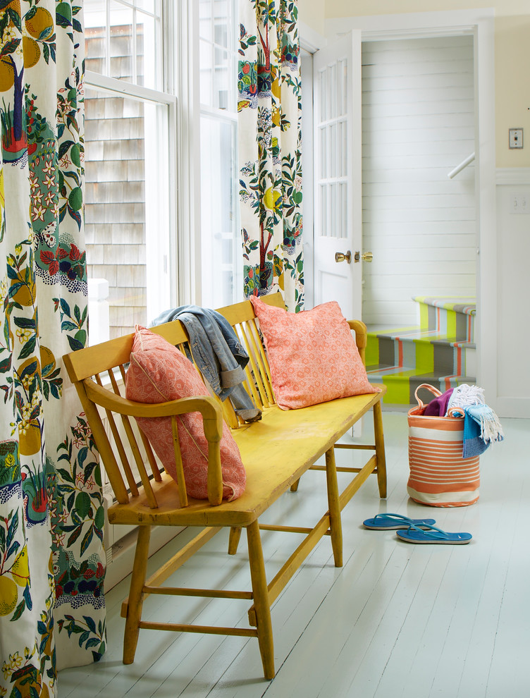 Entry hall - coastal painted wood floor and gray floor entry hall idea in Portland Maine with yellow walls and a white front door