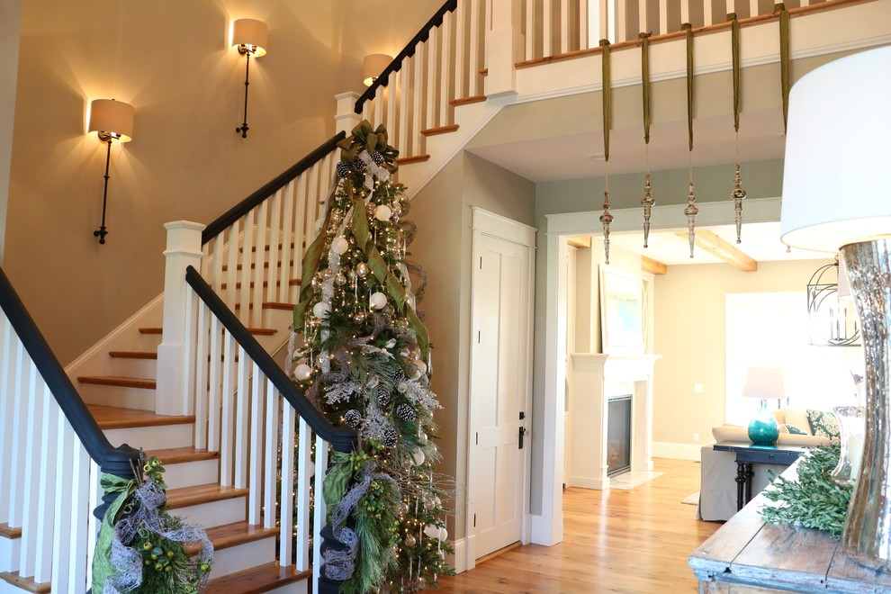 Example of a large cottage medium tone wood floor entryway design in Other with gray walls and a medium wood front door