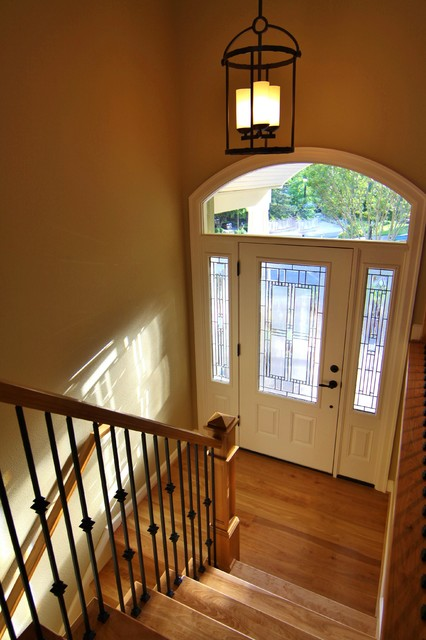 Beautiful new stairway and entry traditional entry for Split foyer remodel