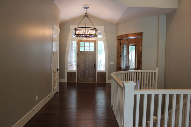 Inspiration for a large transitional medium tone wood floor entryway remodel in Salt Lake City with gray walls and a medium wood front door