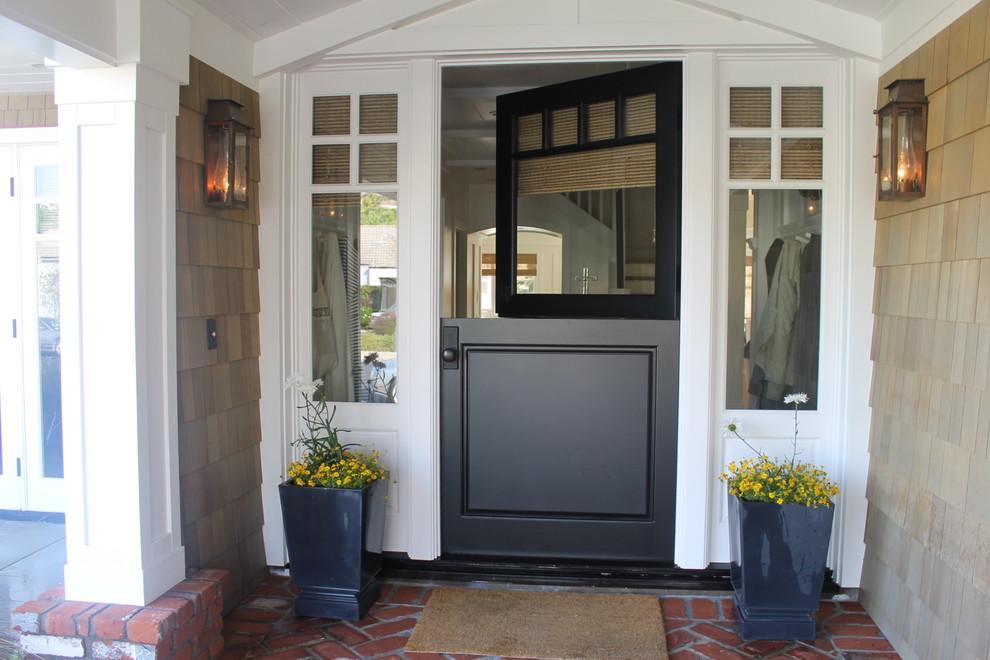 Elegant dutch front door photo in New York with a black front door