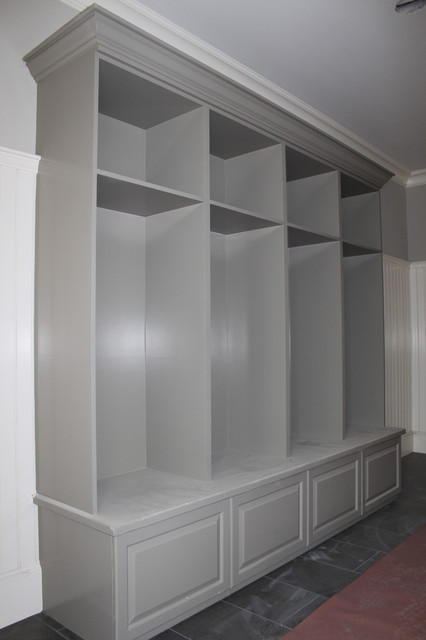 Inspiration For A Large Timeless Ceramic Floor Mudroom Remodel In Boston With White Walls