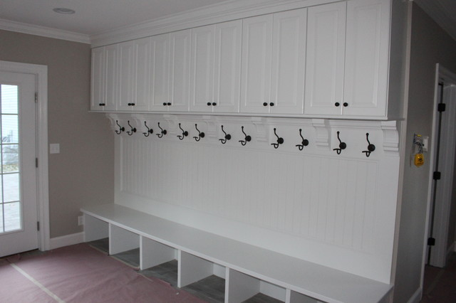 This Is An Example Of A Traditional Boot Room In Boston With White Walls