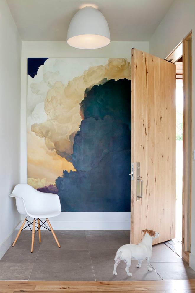 Single front door - contemporary single front door idea in Denver with a light wood front door