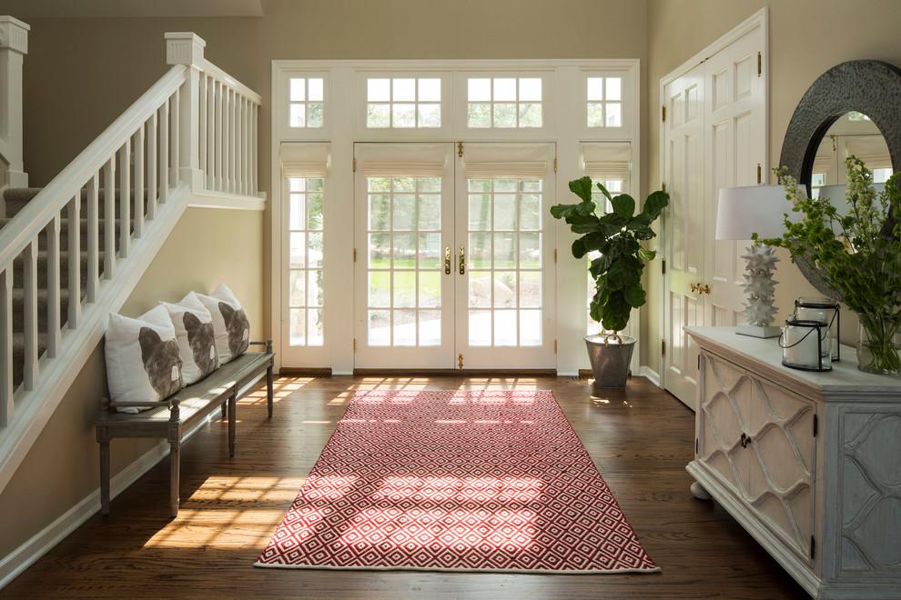Elegant dark wood floor entryway photo in Minneapolis with beige walls and a glass front door