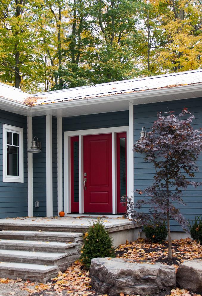 Entryway - traditional entryway idea in Toronto with a red front door