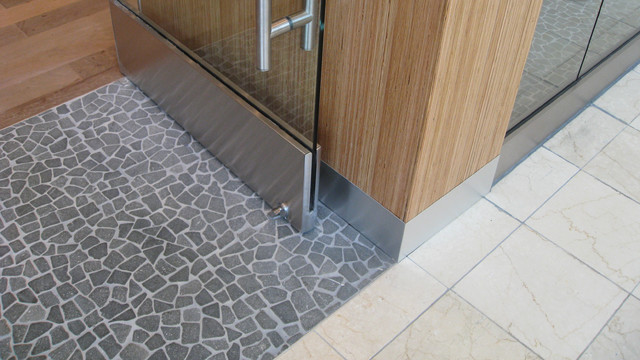 Black flat pebble floor store entrance modern entry for Entrance flooring ideas