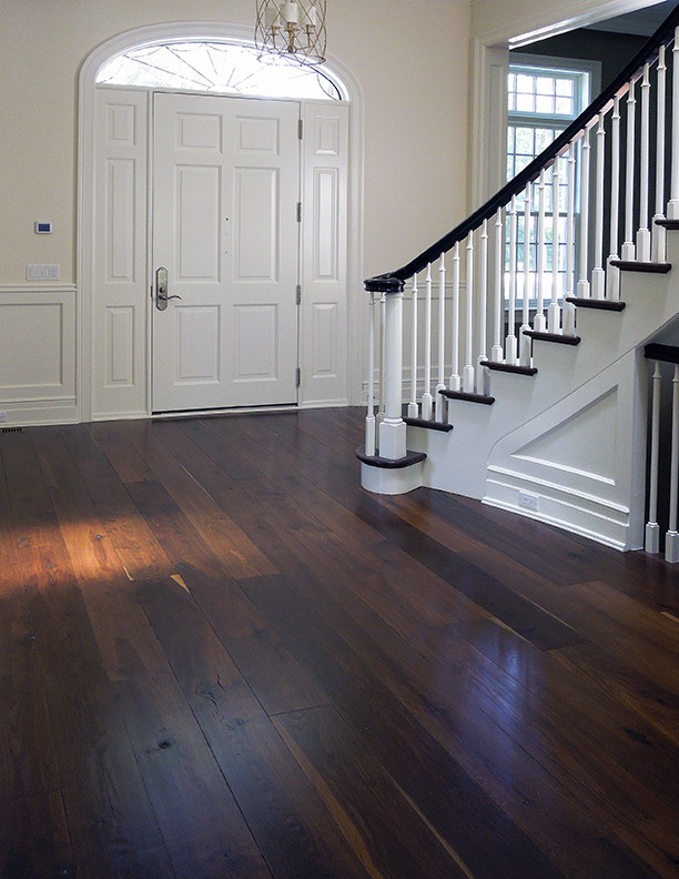 Entryway - contemporary brown floor entryway idea in Chicago