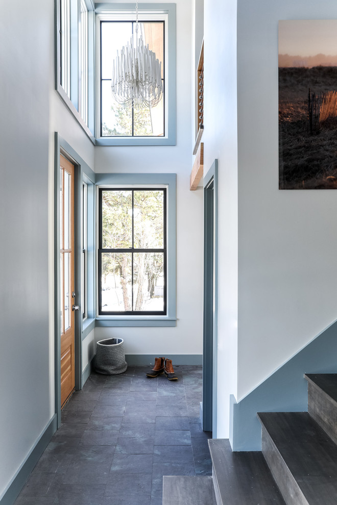 Entryway - mid-sized coastal slate floor and gray floor entryway idea in Portland Maine with white walls and a medium wood front door