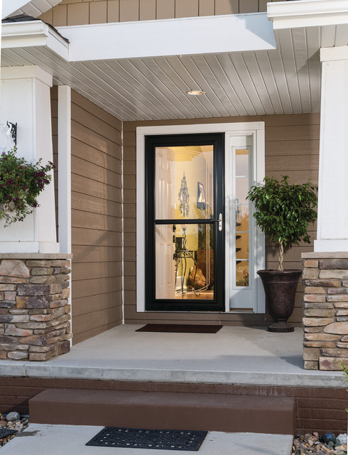 Beau Example Of An Arts And Crafts Entryway Design In Other With A Black Front  Door