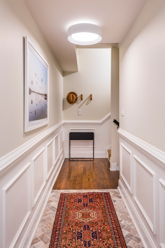 Inspiration for a small transitional limestone floor and brown floor entryway remodel in Philadelphia with white walls