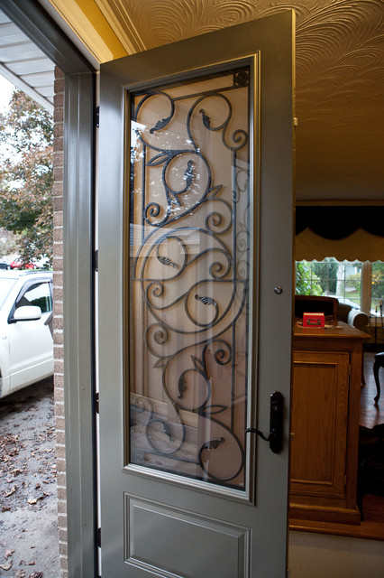 brand new 8ft steel door system with wrought iron inserts entry