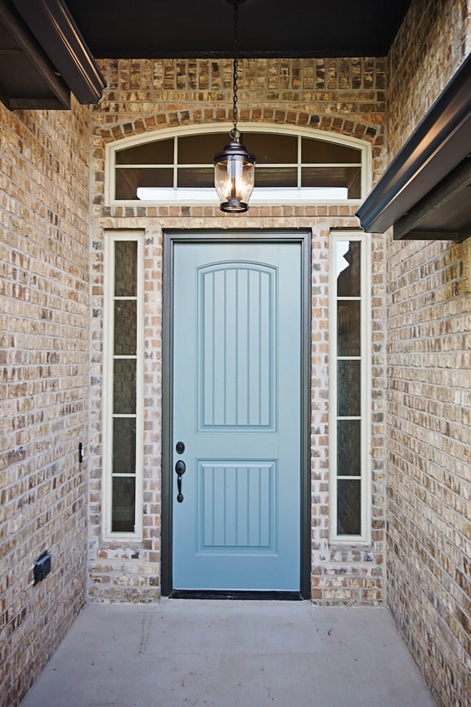 Mid-sized transitional entryway photo in Oklahoma City with a blue front door