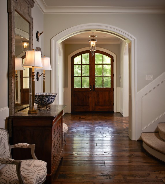 Entryway - mid-sized traditional brown floor and dark wood floor entryway idea in Houston with a dark wood front door and gray walls