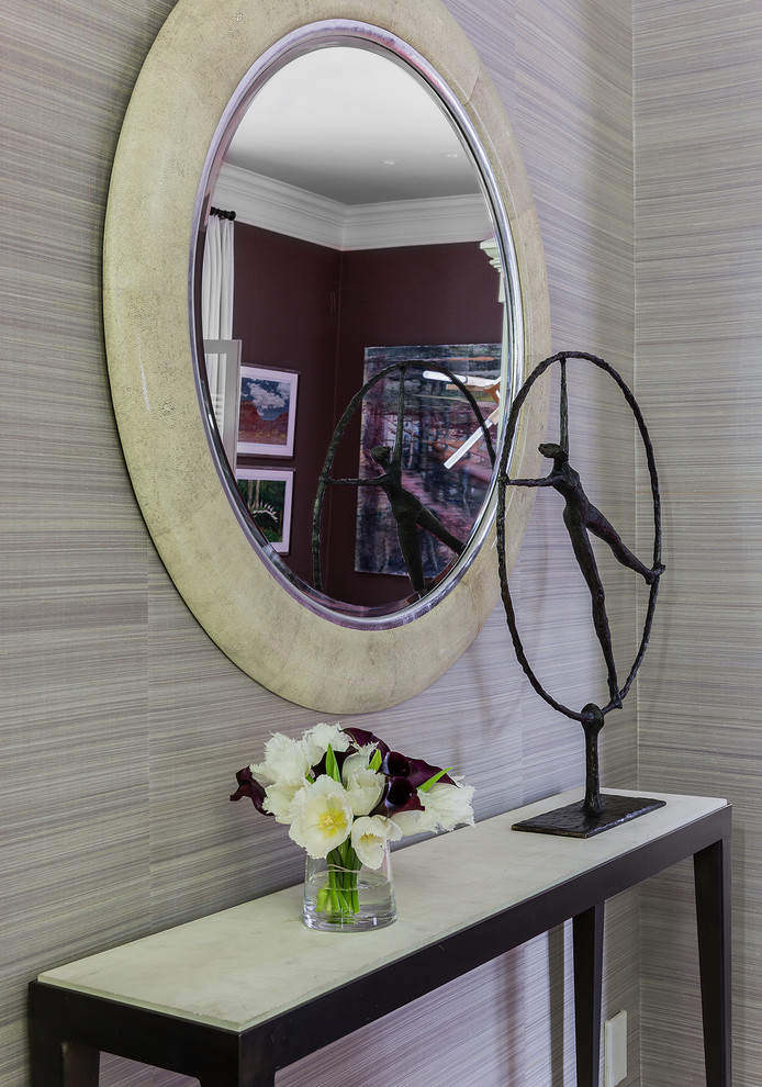 Example of a huge transitional marble floor foyer design in Boston with purple walls