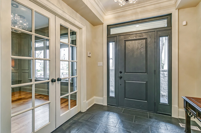 Inspiration for a mid-sized transitional slate floor and gray floor entryway remodel in Toronto with beige walls and a gray front door