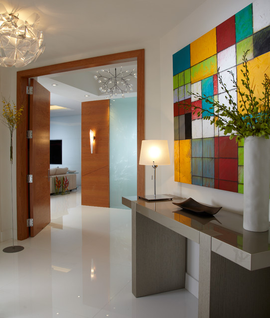 Example of a mid-sized trendy white floor and marble floor vestibule design in Miami with white walls and a medium wood front door