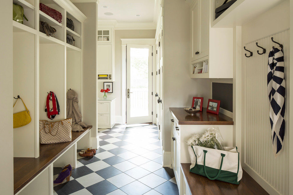 Transitional ceramic tile and multicolored floor mudroom photo in Minneapolis