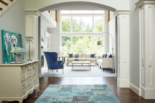 Example Of A Transitional Foyer Design In Minneapolis With White Walls