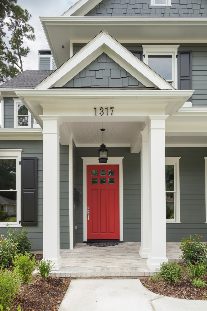 Elegant entryway photo in Houston with a red front door
