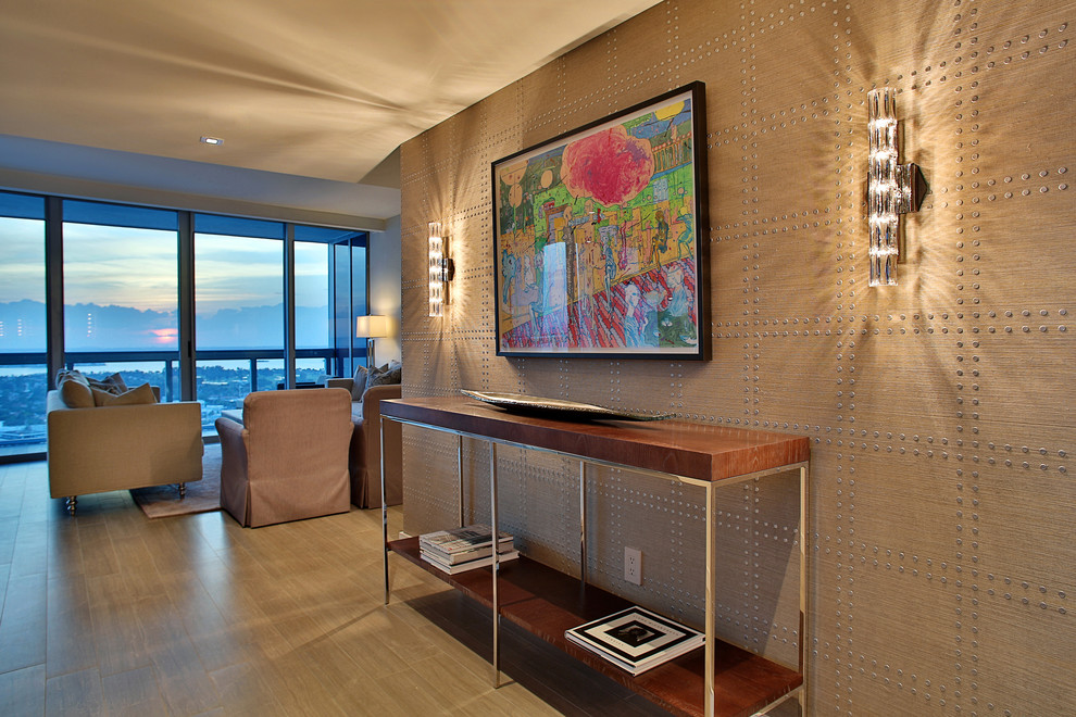 Example of a large trendy porcelain floor entryway design in Miami with beige walls