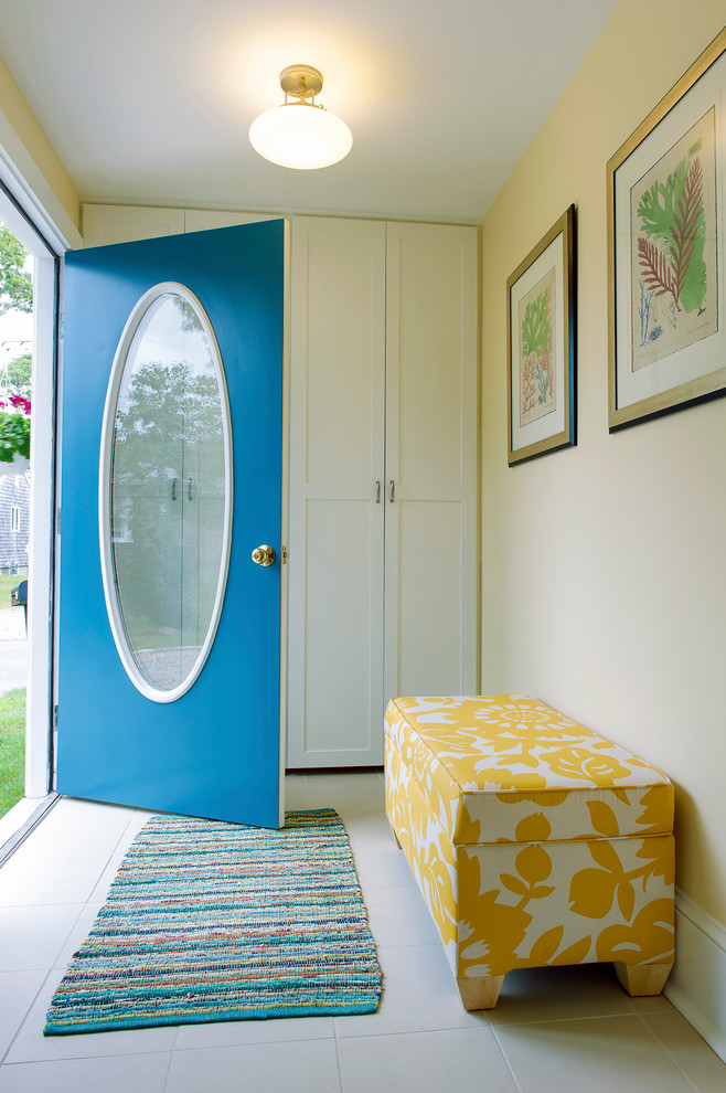 Inspiration for a coastal entryway remodel in Boston with beige walls and a blue front door