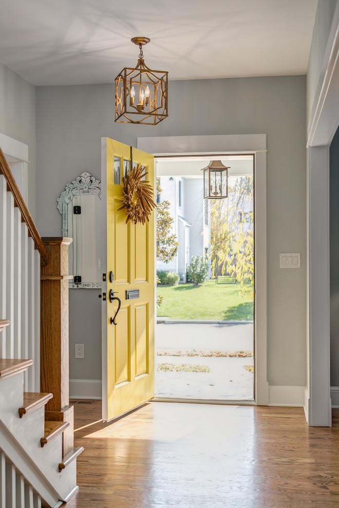 Entryway - mid-sized craftsman medium tone wood floor entryway idea in Orange County with gray walls and a yellow front door