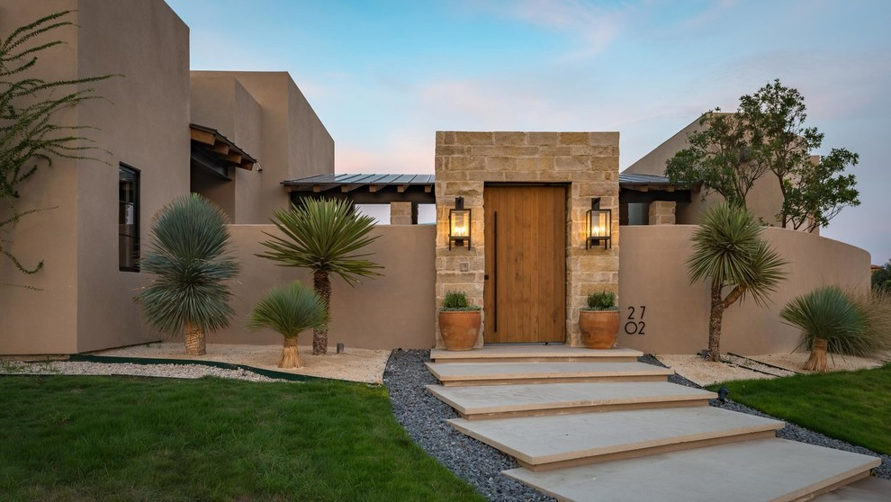 Southwest entryway photo in Austin with a medium wood front door