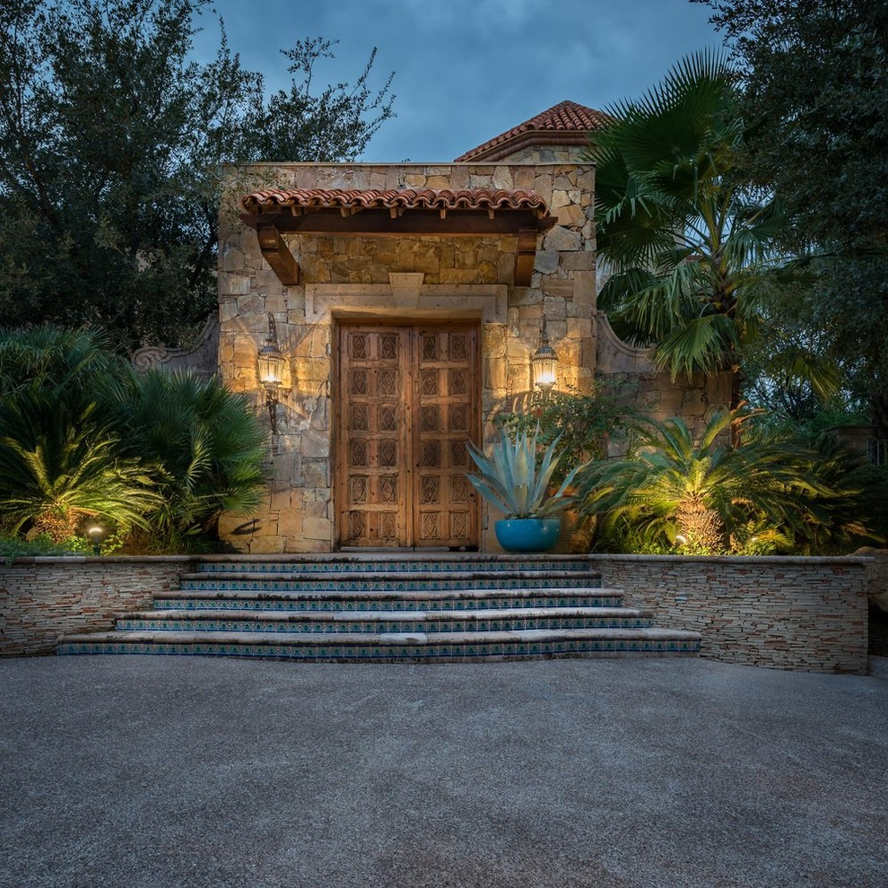 Tuscan entryway photo in Austin