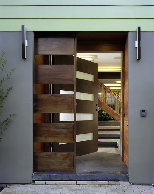 12 seriously cool front door designs that will boost your for Contemporary house main door designs