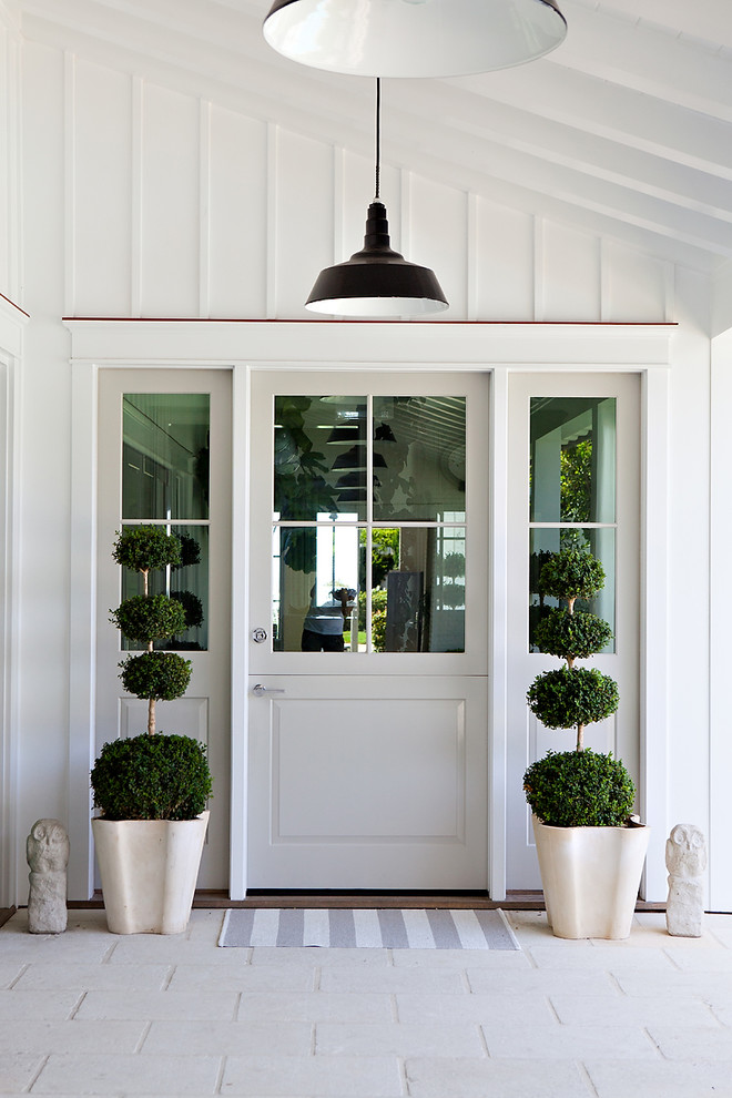 Entryway - beach style entryway idea in Orange County with a glass front door