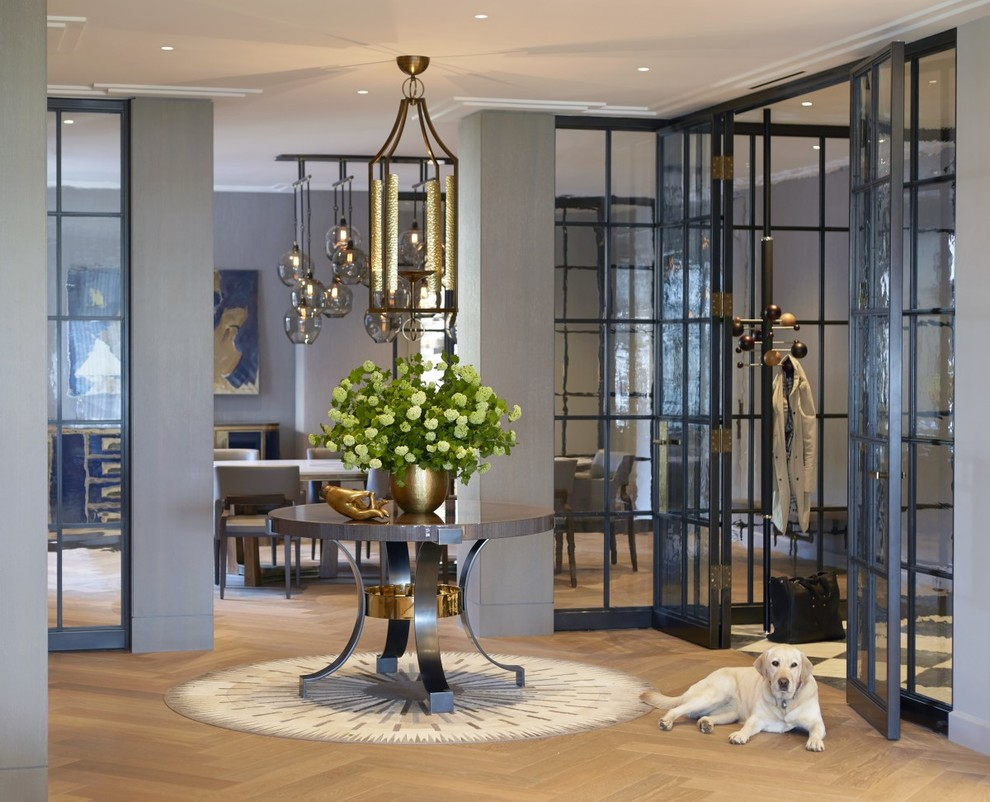 Inspiration for a transitional light wood floor foyer remodel in New York with gray walls