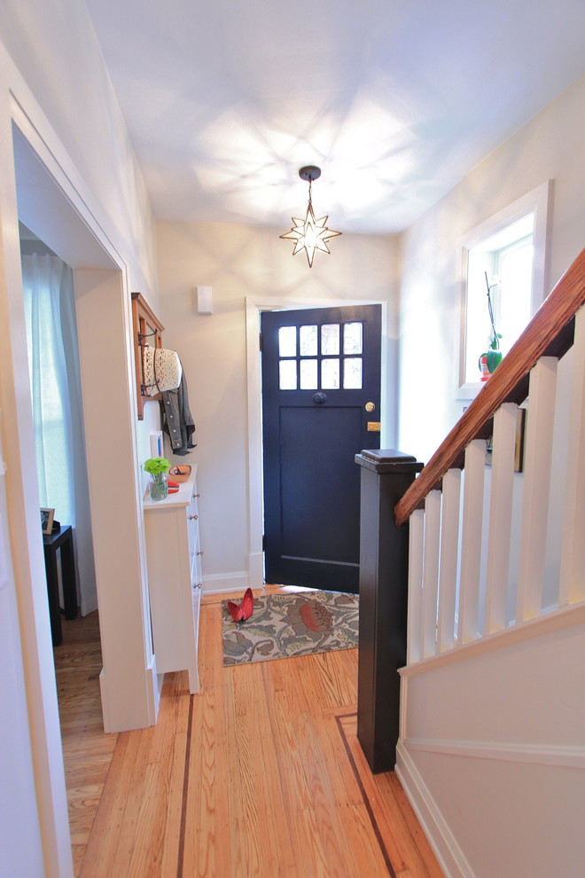 Example of a small eclectic light wood floor entryway design in Toronto with a blue front door and gray walls