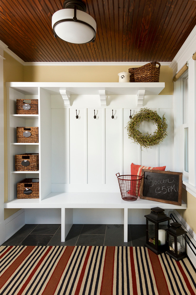 Inspiration for a craftsman mudroom remodel in Minneapolis with yellow walls
