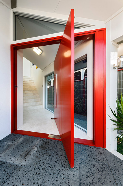 Inspiration for a contemporary entrance in Perth with a pivot front door and a red front door.