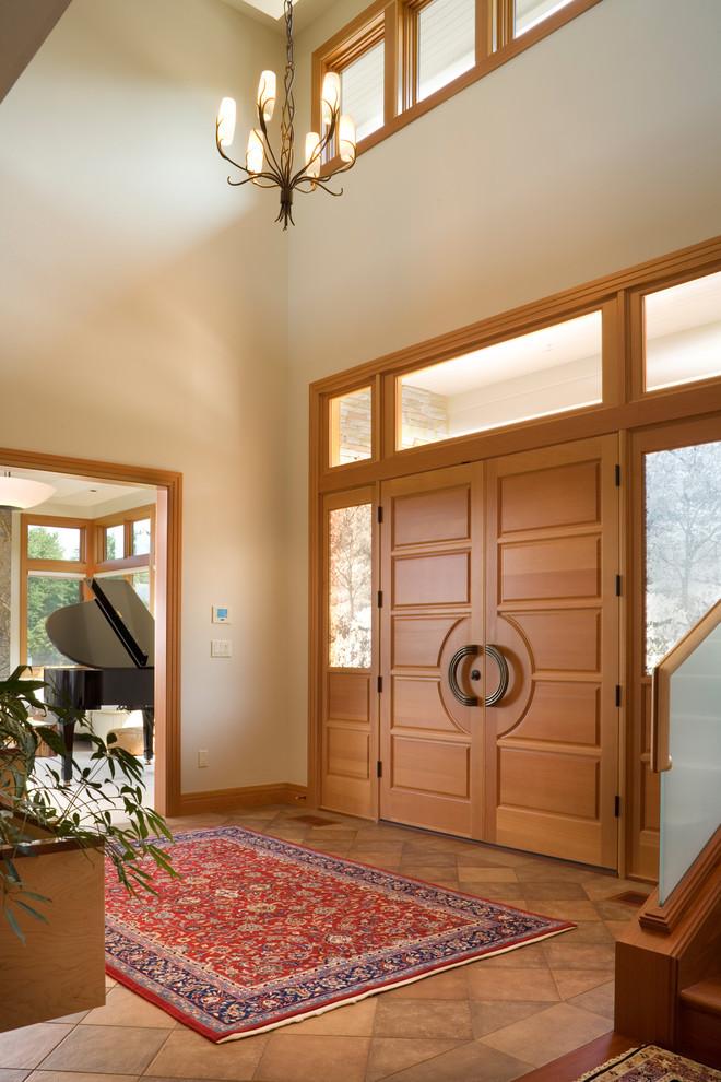 Double front door - contemporary double front door idea in Portland with beige walls and a medium wood front door