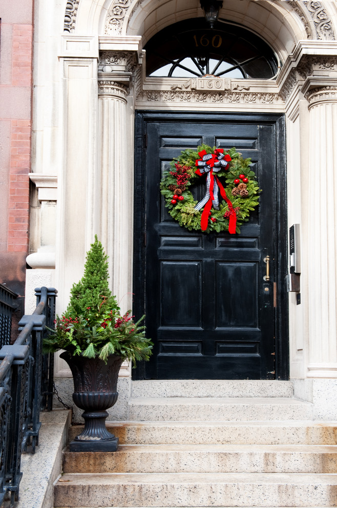 Example of a classic entryway design in Boston with a black front door