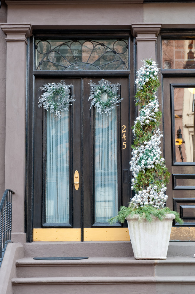Inspiration for a timeless entryway remodel in Boston with a black front door