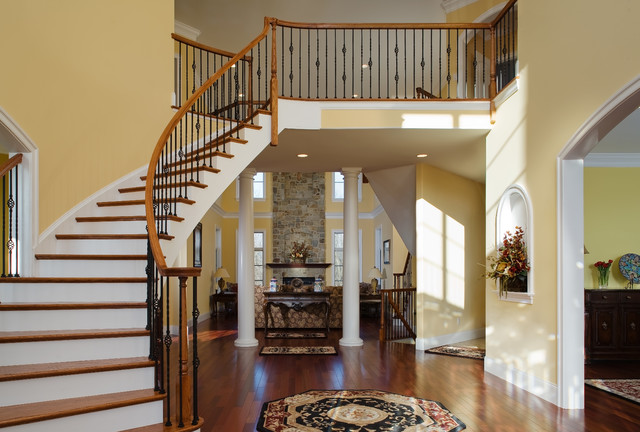 Circular Stair In Grand Foyer Traditional Entry