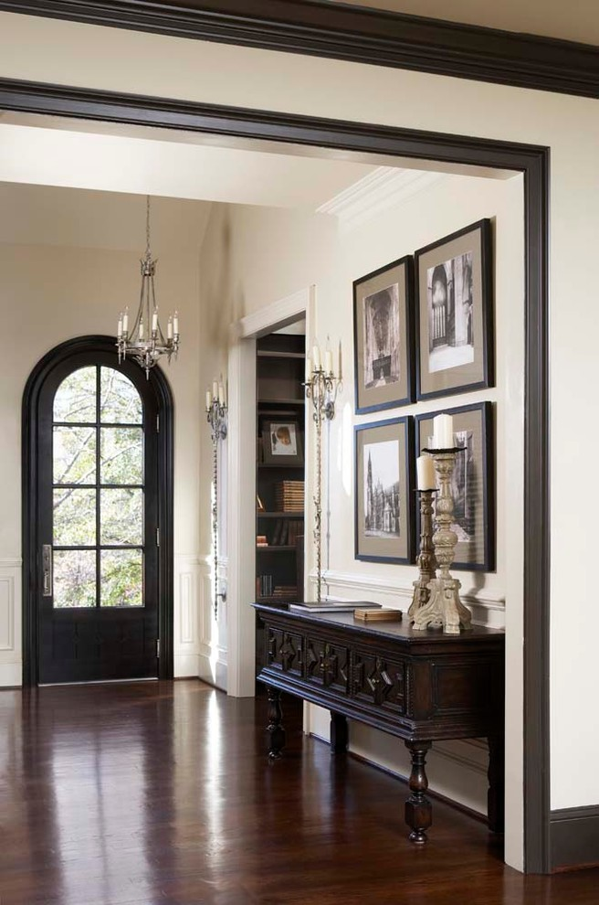 Large elegant dark wood floor single front door photo in Other with a black front door and white walls