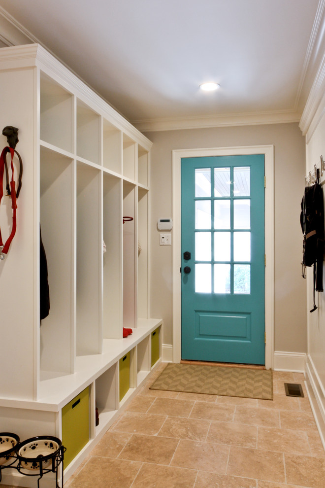 Example of a classic travertine floor entryway design in Newark with gray walls and a blue front door
